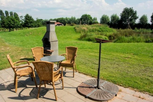 Huisje Waterkant - Terras Vakantiehuis veluwe, vakantiehuisje, veluwe, vakantiepark, nieuw grapendaal, appelhof, Waterkant