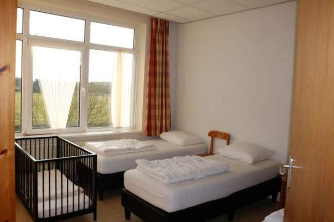 Slaapkamer met kinderledikant