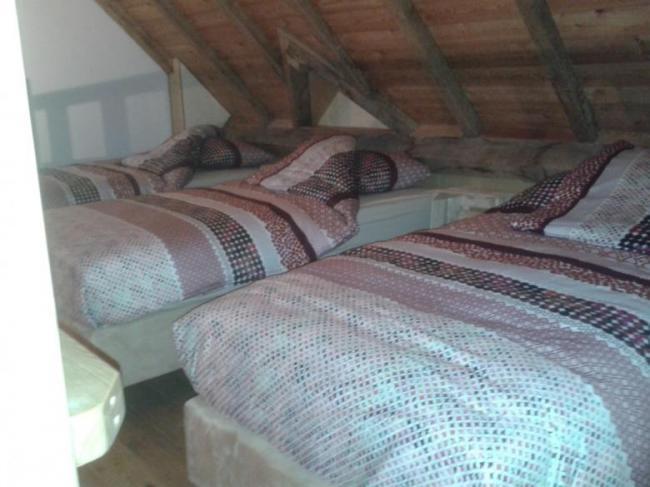 Vakantie Meerlo De Schuur vijfpersoons slaapkamer, 3 bedden op de vide, 2 op de begane grond van deze slaapkamer