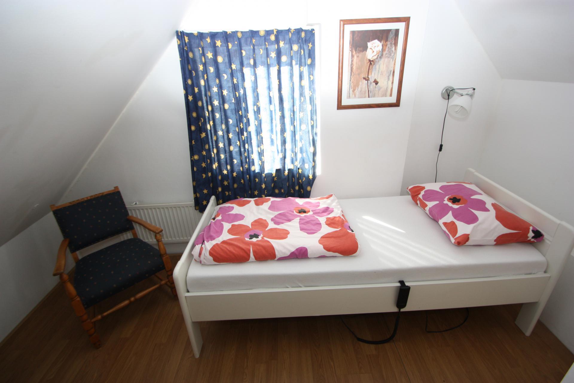 Slaapkamer met twee éénpersoonsbedden
