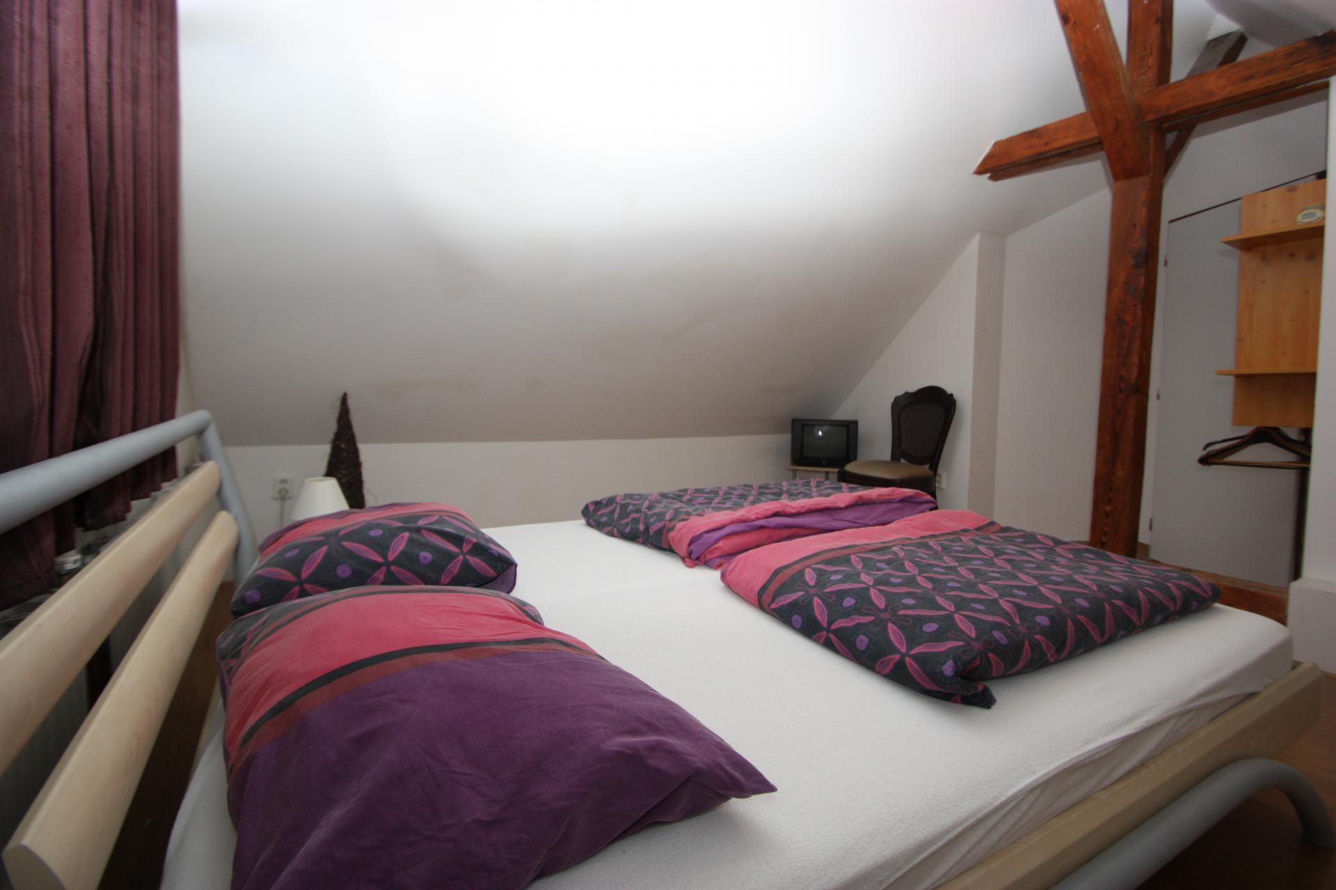 Slaapkamer met tweepersoonsbed